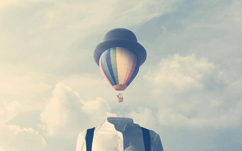 hombre con un gran globo vuela en la cabeza, concepto surrealista